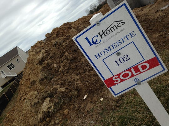 """Sold"" is the sign of the times at the Windstone community near Milton, where half of the 360 home sites are spoken for."