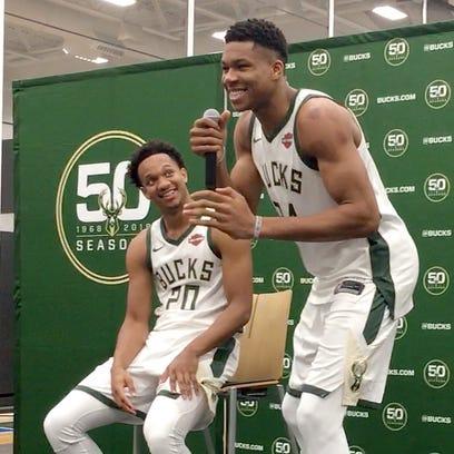 Milwaukee Bucks Giannis Antetokounmpo, right, tells