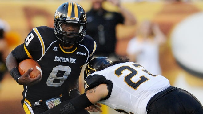 Southern Miss running back Tez Parks (8) gets past Appalachian State's Brandon McGowan (22) during a game last season.