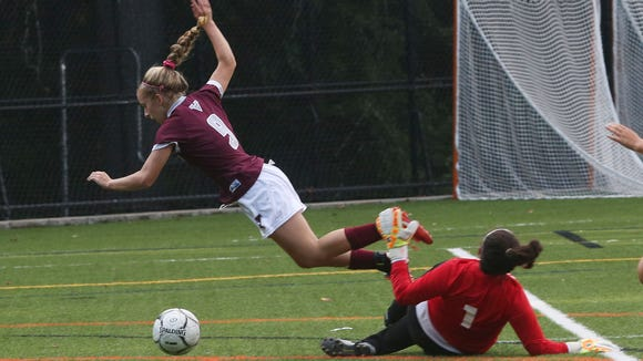 From left, Valhalla's Shannon Brosnan (9) goes flying