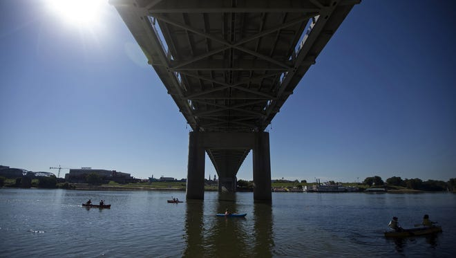 Paddlers cross under the Taylor–Southgate Bridge as they come to the end of a 2014 race.
