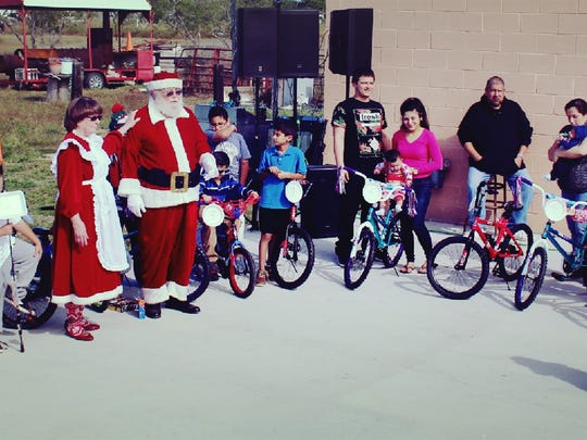 Bike raffle winners with Santa and Mrs. Claus