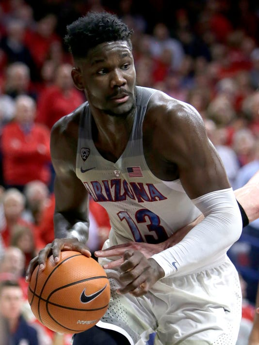 FILE - In this Thursday, Jan. 11, 2018 file photo, Arizona forward Deandre Ayton (13) in the first half during an NCAA college basketball game against Oregon State in Tucson, Ariz. Oklahoma's Trae Young, Duke's Marvin Bagley III and Arizona's Deandre Ayton lead the list of top performers in college basketball as the season crosses its midway point. (AP Photo/Rick Scuteri)