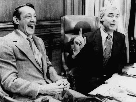 San Francisco Supervisor Harvey Milk (left) and Mayor George Moscone sit in the mayor's office in this April 1977 photo.