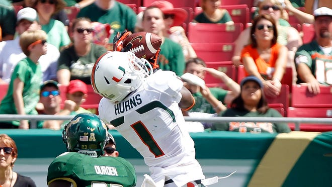 Miami Hurricanes wide receiver Allen Hurns (1) catches the ball during the first half against the South Florida Bulls at Raymond James Stadium.