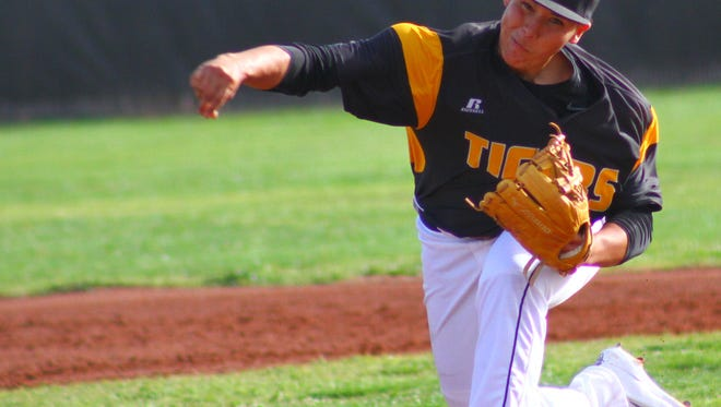 Alamogordo junior Gavin Guerra releases a pitch during the first game of a doubleheader Tuesday afternoon at Tiger Field.
