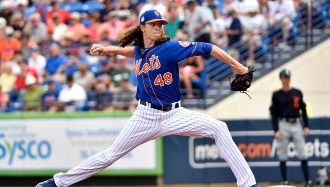 New York Mets starting pitcher Jacob deGrom (48) throws against the Detroit Tigers during a spring training game at First Data Field.