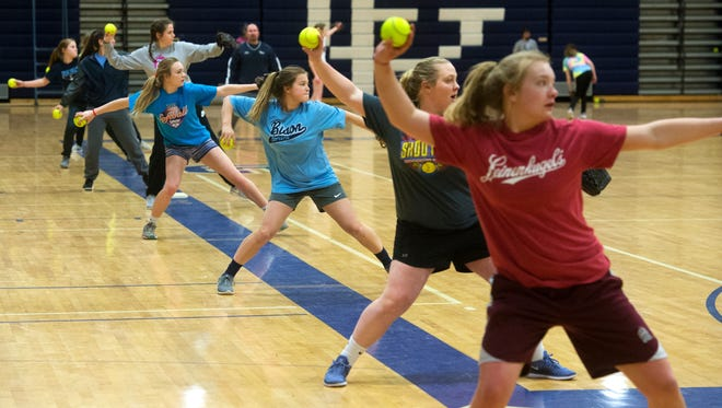 Senior Cayley Bushong and the Great Falls High softball team practices in the Swarthout Fieldhouse last Friday afternoon, after the Great Falls Softball Jamboree was called due to snow.