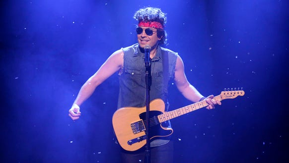 Host Jimmy Fallon as Bruce Springsteen on December