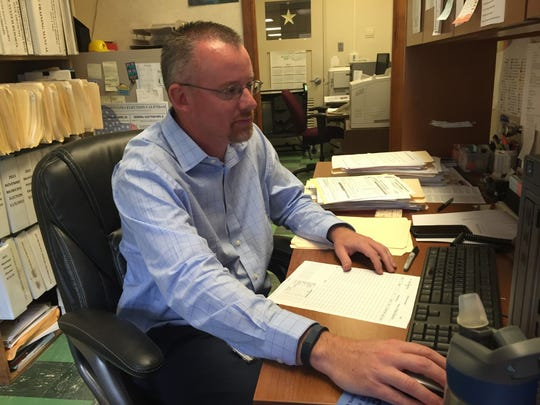 Lebanon County Voter Registration Office director, Michael Anderson, who started on Monday, gets to work in his office at the Lebanon Municipal Building.