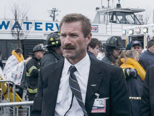Aaron Eckhart (and his glorious mustache) appears in