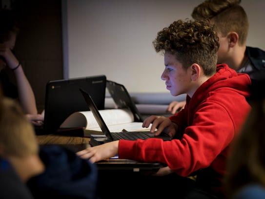 Mon., Jan. 30, 2017: Bryson Vega works on math at Conner