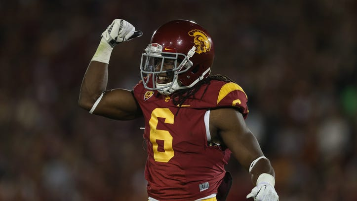 LOS ANGELES, CA - NOVEMBER 16:  Safety Josh Shaw #6 of the USC Trojans celebrates against the Stanford Cardinal at Los Angeles Coliseum on November 16, 2013 in Los Angeles, California.  (Photo by Jeff Gross/Getty Images)