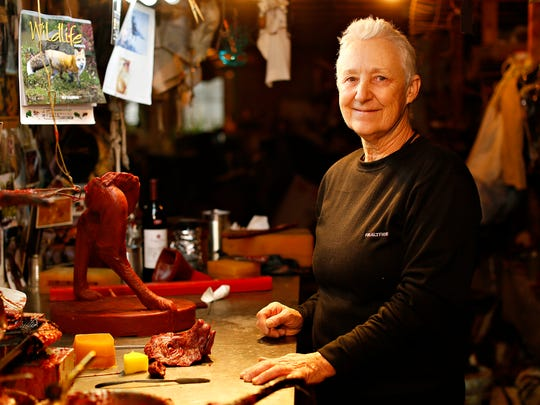 Artist Lorann Jacobs is shown amidst her projects and
