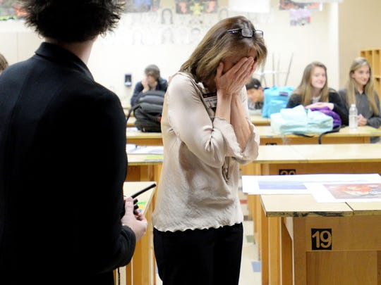 Parkway teacher Debi Jacobe gets emotional as she watches the video by student Andrianna Williams announcing the Ving Project.