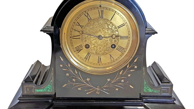 This Roblin & Fils Freres slate and inlay mantle clock recently sold for $236 at auction.