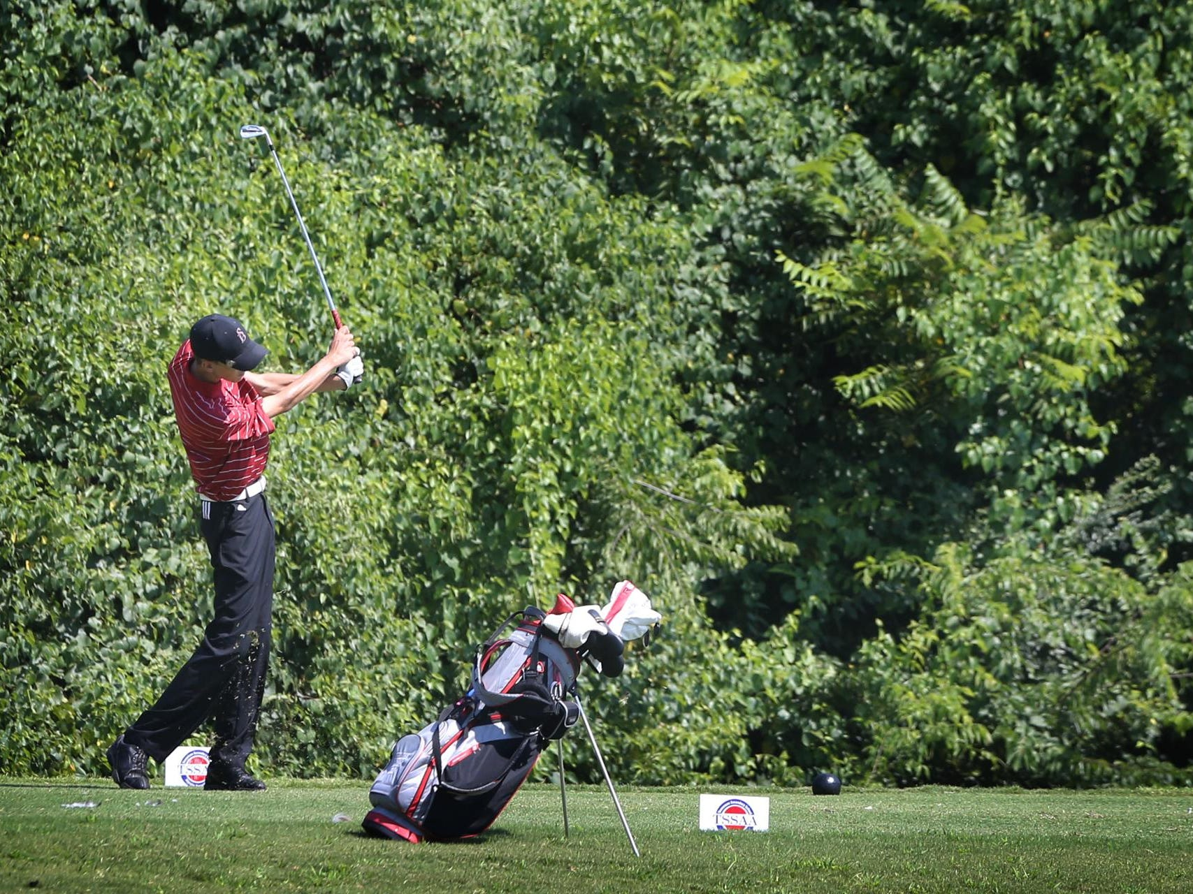 Stewarts Creek's Shelden Barina tees off during the Stones River Invitational on Monday.