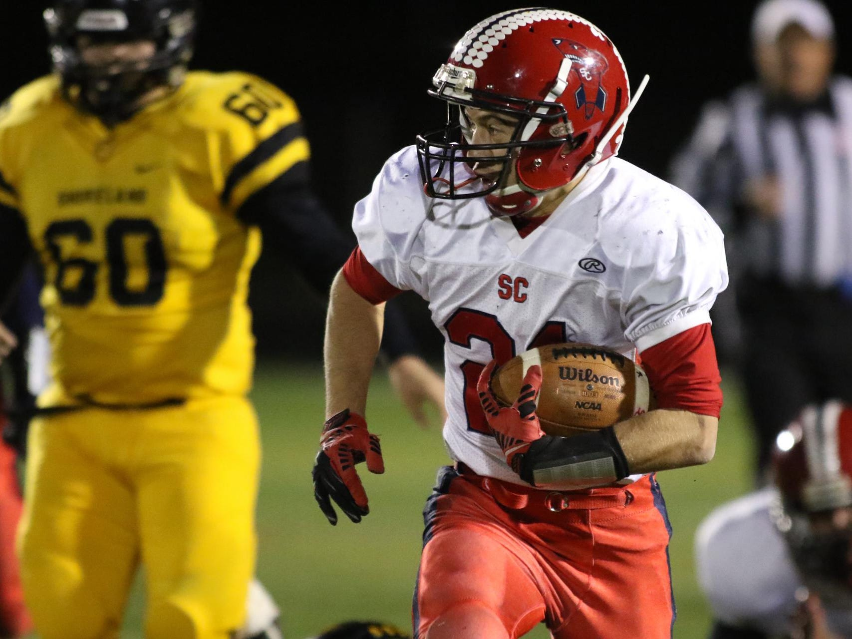 Running back Noah Zastrow looks to his left as he bolts for a touchdown run in the first quarter as Spencer/Columbus demolished Shoreland Lutheran, 50-7 in Ripon, Friday, November 13, 2015.