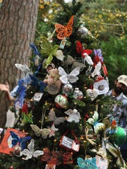 The Bereaved Parents of Cenla decorated the butterfly tree in the Alexandria Zoo on Sunday afternoon. The tree will remain up through January.