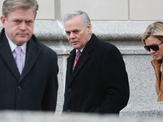 Christopher St. Lawrence, center, leaves the White Plains federal courthouse after a pre-sentencing hearing.