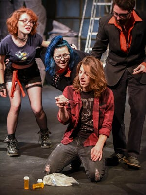 Tanner Strunk, who plays Johnny, uses narcotics Monday, is tempted by Jaclyn Radford, Megan Strachan and his alter ego, played by Tyler Gates, Oct. 30 during a dress rehearsal of Green Day's American Idiot play at St. Clair County Community College.