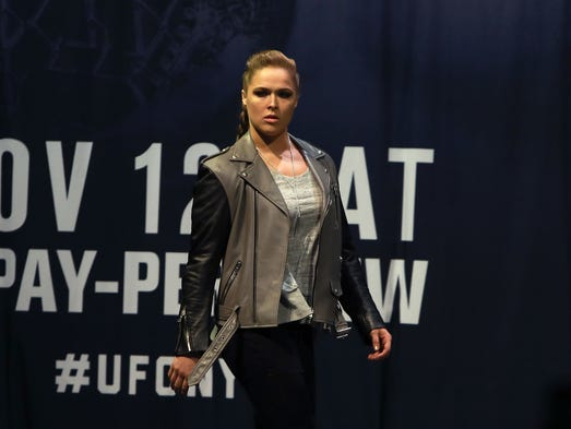 Ronda Rousey walks on stage for her faceoff with UFC