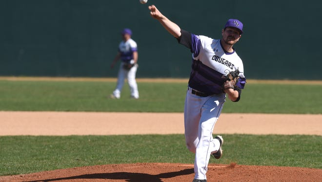 University of Sioux Falls (USF) Cougars starting pitcher Dylan Gavin (22) throws the ball during the first inning against the Augustana Vikings on Wednesday, April 25, 2018 at the Sioux Falls Stadium in Sioux Falls, S.D.