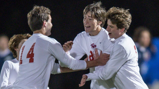 Jackson Prep's Brent Hall, center, and Hunter Patterson, right, celebrate a goal by Hall against Jackson Academy on Thursday.
