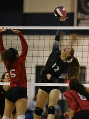 Randolph junior Jamie Pringle goes up for a kill during