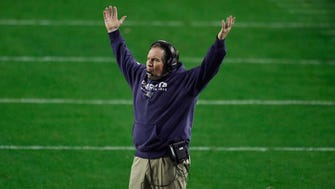 New England Patriots head coach Bill Belichick reacts to an interception of a Seattle Seahawks touchdown pass during the fourth quarter against the Seattle Seahawks in Super Bowl XLIX at University of Phoenix Stadium.