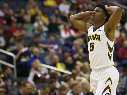 Iowa forward Tyler Cook (5) reacts on the court against