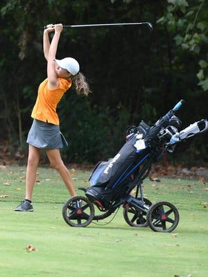 South Gibson County's Rachel Tiger follows her ball after her swing during the Fellowship of Christian Athletes boys and girls golf tournament Aug. 7.