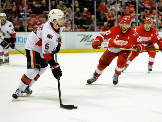 Ottawa Senators defenseman Chris Wideman (6) keeps the puck away from Detroit Red Wings left wing Henrik Zetterberg (40) of Sweden during the second period of an NHL hockey game, Monday, April 3, 2017, in Detroit. (AP Photo/Jose Juarez)