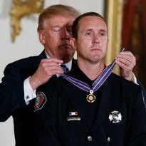 Peoria firefighter, who rescued man from house fire, awarded Medal of Valor