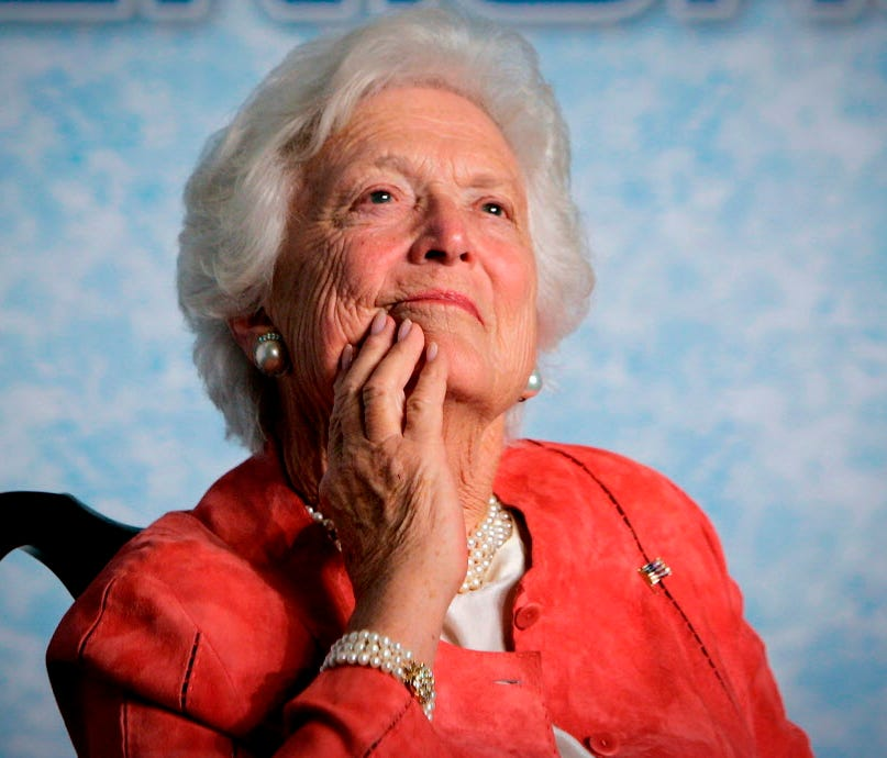 Former first lady Barbara Bush listens to her son, President George W. Bush, as he speaks on Social Security reform in Orlando on March 18, 2005.
