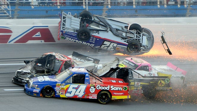 Camping World Series drivers Miguel Paludo (32) , Darrell Wallace Jr. (54) , Jeb Burton (4) and Kyle Busch (51) are involved in a crash on the last lap during the Freds 250 at Talladega Superspeedway.