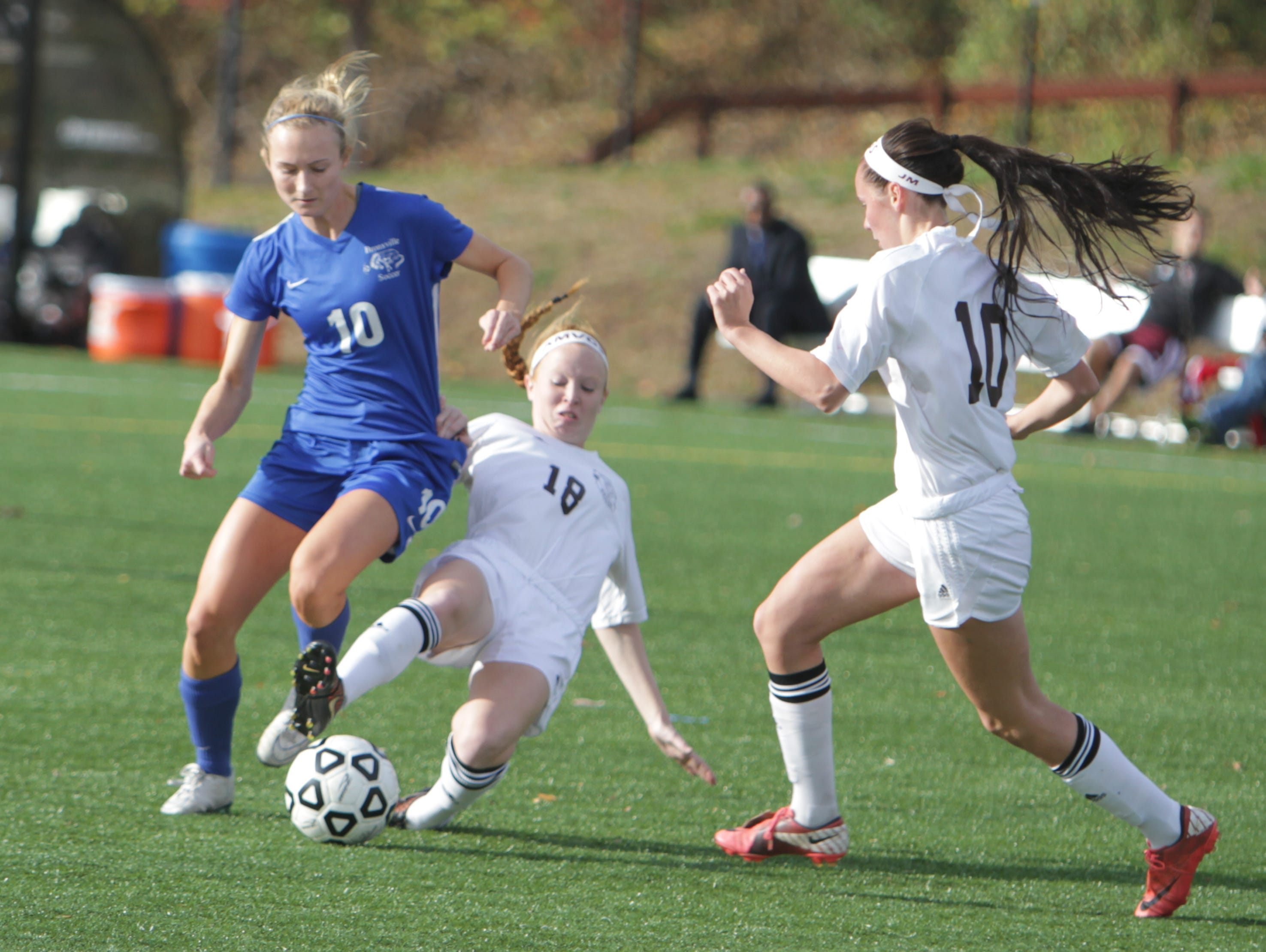 Albertus Magnus' Carly Clinton attempts a slide tackle on Bronxville's Mason Warble during a Section 1, Class B semifinal game at the Orangetown Soccer Field Complex on Thursday, October 29th, 2015. Albertus Magnus won 1-0.