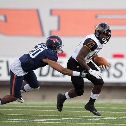 Southern Miss receiver Korey Robertson (18) attempts