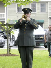 Retired Sgt. 1st Class Jim Lanpher, from the 40th Army Band of the Vermont National Guard, plays taps at a Memorial Day ceremony in Vergennes in 2015.