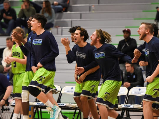 Providence men's basketball players celebrate during the Argos' contest against MSU-Northern.