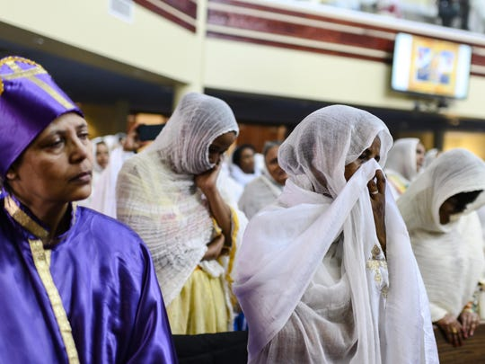 Members of the Ethiopian community take part in a special prayer for the victims of the Ethiopian Airlines flight ET302 crash, at the Ethiopian Orthodox Tewahedo Church of Canada Saint Mary Cathedral in Toronto, on Sunday.