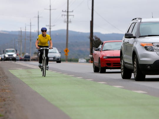 Ariana Green, transportation planner for the Transportation Agency for Monterey County, rides the green cycling lane on Davis Road Wednesday in Salinas. The lane is part of the agency's proposed Multimodal Corridor project running from Salinas to Monterey.