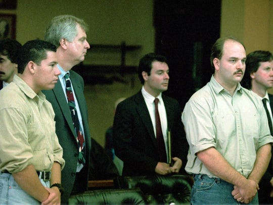 Suspects in the Nancy Kerrigan assault case, Shane Stant, left foreground, and Derrick Smith, second from right, stand with their lawyers during a court appearance in Multnomah County Circuit Court in Portland, Friday, Jan. 21, l994. From far left, Robert Goffredi, out going lawyer, Stant, his new lawyer, Randall Vogt, Michael McShane, lawyer for Smith, Smith, and John Conners, also a lawyer for Smith.(AP Photo/Jack Smith)