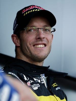 Sebastian Bourdais before an IndyCar auto race Saturday, April 7, 2018, at Phoenix International Raceway in Avondale, Ariz. (AP Photo/Rick Scuteri)