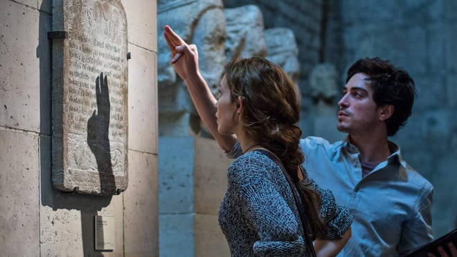 """Perdita Weeks, left, and Ben Feldman are shown in a scene from """"As Above, So Below."""""""