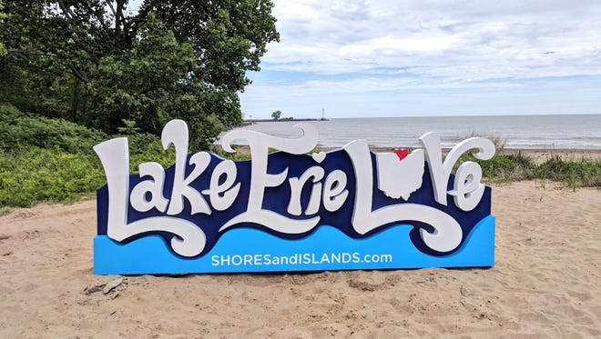 """A """"Lake Erie Love"""" in Huron, Ohio, offers beachgoers a chance to take photos of and pose with it. The Lake Erie Shores & Islands tourism bureau hopes to work with other communities to post more """"Love"""" signs."""