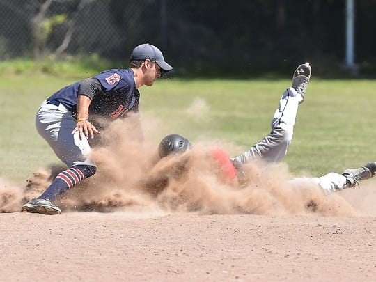 Kolberg runner Hunter Pawleski is steals second base manned by Tom Sawyer of Sister Bay during a Door County League baseball game at Kolberg on Sunday.