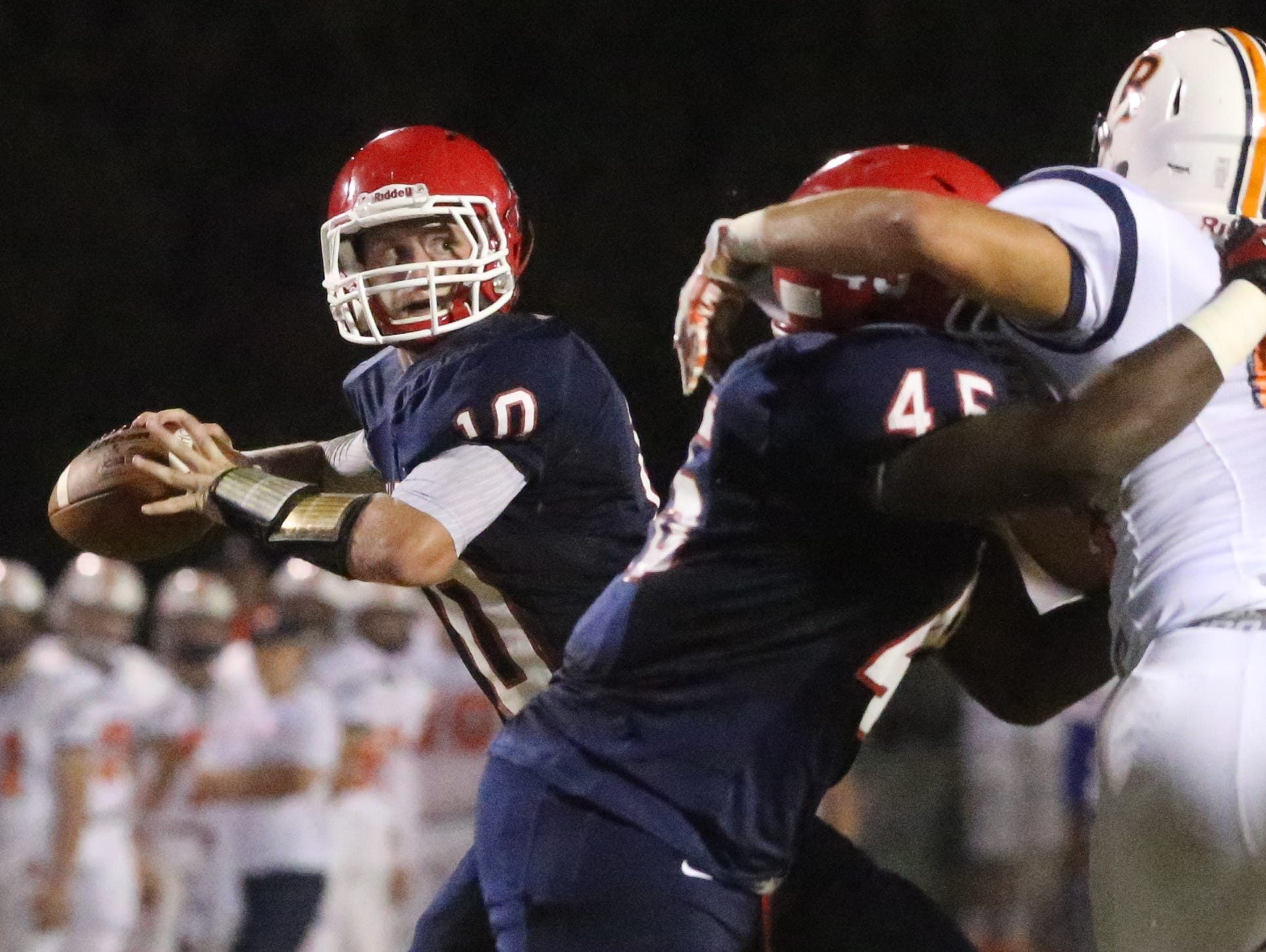 Oakland quarterback Brendan Matthews throws a pass during the Patriots 21-7 win on Friday night.
