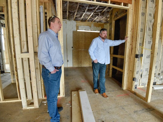 Eric Brough, left, vice president and Jeff Garrison, president and owner of Garrison Homes in a new home construction site in Rehoboth Beach.