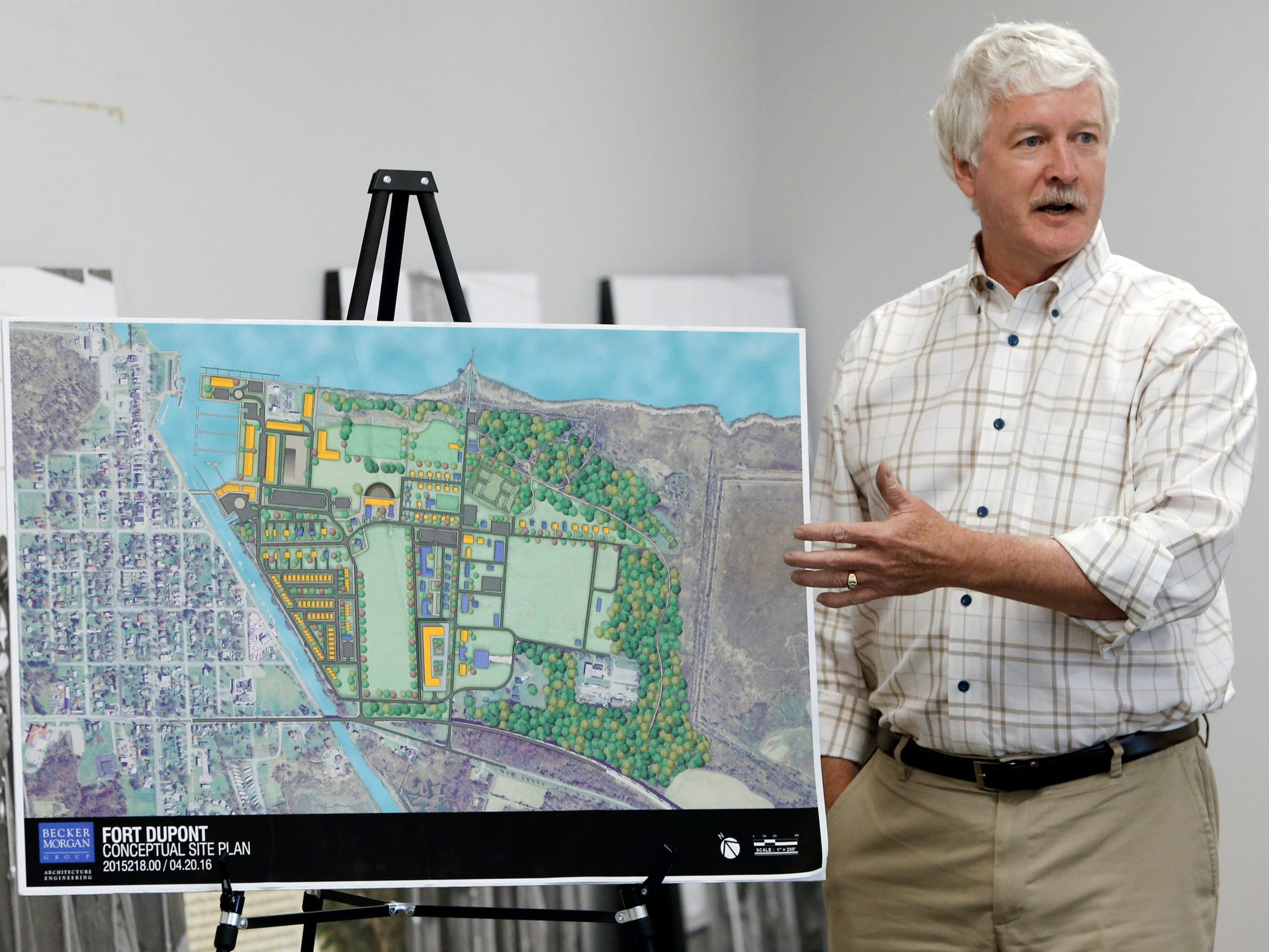 Jeffrey Randol, director of the Fort DuPont Redevelopment Corporation, discusses the master plan for the fort's reuse and possible annexation by Delaware City at the Delaware City Library Tuesday.